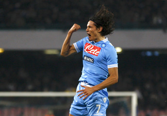 Napoli's Cavani celebrates after scoring against AS Roma during Italian Serie A soccer match in Naples