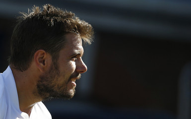Switzerland's Wawrinka reacts during his match with Australia's Matosevic at the Queen's Club Championships in west London