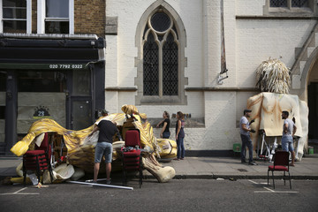 People decorate a float ahead of the Notting Hill Carnival in London