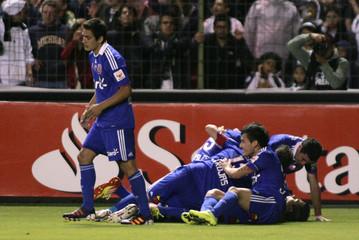 Universidad de Chile's players celebrate goal against Ecuador's LDU during first leg Copa Sudamericana final soccer match in Quito