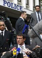 French Interior Minister Manuel Valls speaks to the media after a meeting at the police headquarters in Grenoble