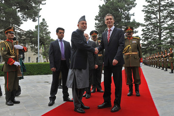 Afghanistan's President Hamid Karzai shakes hands with Norway's Prime Minister Jens Stoltenberg at the Presidential Palace in Kabul