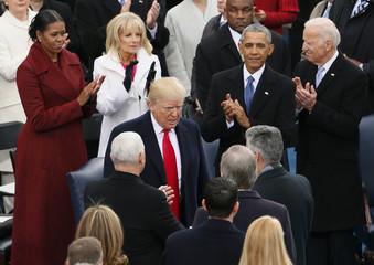 President Barack Obama and Vice president Joe Biden as President-elect Donald Trump arrives at the inauguration ceremonies in Washington