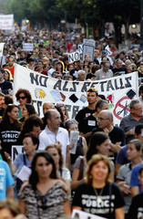 Protesters march during a demonstration against educational cuts in Valencia