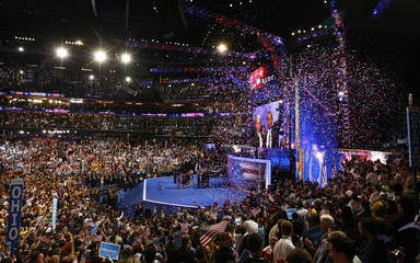 Confetti falls as U.S. President Barack Obama and Vice President Joe Biden gather with their families  onstage after addressing final session of Democratic National Convention in Charlotte
