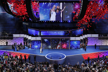 Democratic presidential nominee Clinton waves with her vice presidential running mate Senator Kaine and wife Anne as fireworks burst after Clinton accepted the nomination on the fourth and final night at the Democratic National Convention in Philadelphia