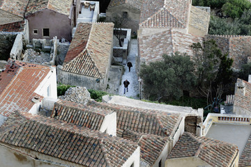 People make their way along the streets of the town of Monemvasia