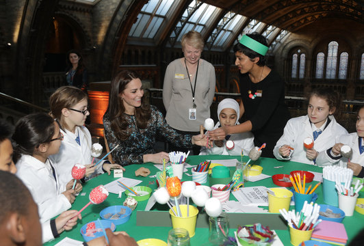 Britain's Catherine, Duchess of Cambridge makes a dinosaur egg whilst attending a children's tea party  to celebrate Dippy the Diplodocus's time in Hintze Hall with pupils from Oakington Manor Primary School, at the Natural History Museum in London