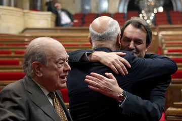 New Catalan President Mas is congratulated by Spanish politician Lleida during the second investment session in Barcelona