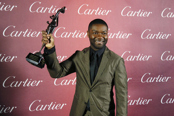 Actor David Oyelowo poses with his Breakthrough Performance Award - Actor backstage at the 26th Annual Palm Springs International Film Festival Awards Gala in Palm Springs