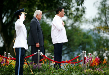 Philippines President Rodrigo Duterte prepares to inspect an honour guard with Singpapore's President Tony Tan at the Istana in Singapore