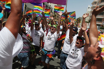Participants wear T-shirts printed with a tribute to the victims of the shooting at the Pulse night club in Orlando, during the annual gay pride parade in San Juan, Puerto Rico