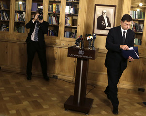 Latvia's Prime Minister Valdis Dombrovskis leaves a news conference in Riga