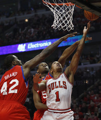 Chicago Bulls' Rose goes to the basket against Philadelphia 76ers' Brand and Allen during quarter-final playoff basketball game in Chicago