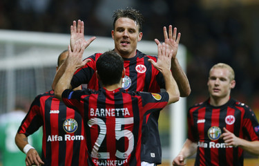 Eintracht Frankfurt's Meier celebrates with his team mates after scoring with a header against Tel Aviv during their Europa League Group F soccer match in Frankfurt