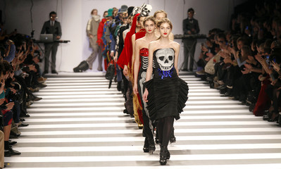 Models present creations by French designer Jean-Charles de Castelbajac during Paris Fashion Week