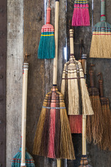 Colorful broom on the wodden w