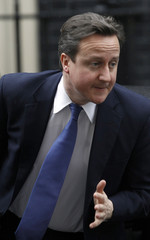 Britain's Prime Minister David Cameron, arrives in Downing Street in central London