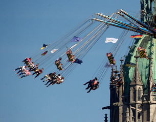 Visitors ride a merry-go-round during Oktoberfest in Munich