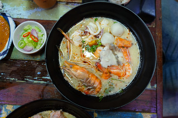 Tom Yum Kung with noodles and seafood