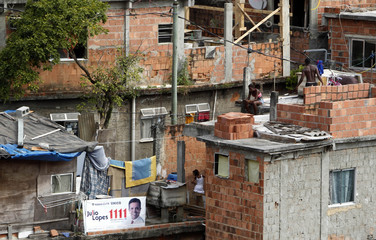 An election campaign poster is seen at Cantagalo slum in Rio de Janeiro