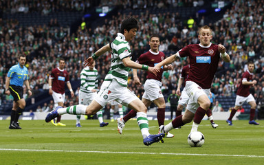 Celtic's Ki runs with the ball against Hearts during their Scottish Cup semi-final soccer match in Glasgow