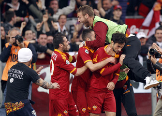 AS Roma's Vucinic celebrates with his teammates after scoring against Lazio during their Serie A soccer match at Olympic stadium in Rome