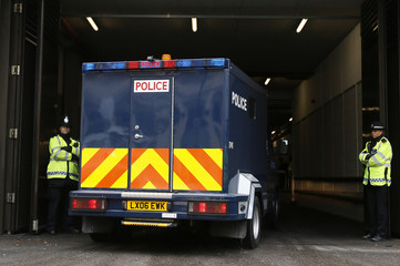 A police van thought to be carrying Michael Adebowale arrives at Westminster Magistrates Court in London