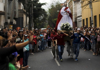 Devoted Catholics from Honduras carry a statue of a Saint as they participate in an Easter Sunday procession in Tegucigalpa