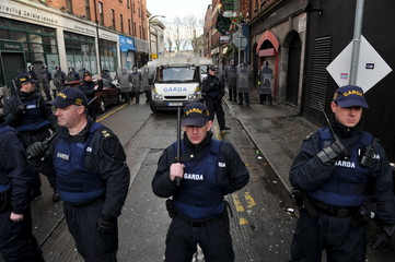 Members of the Garda Public Order Unit and riot police attend a anti-racism demonstration against the launch of an Irish branch of PEGIDA