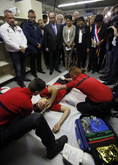 """French President Hollande attends a security exercise with students during a visit at a vocational high school """"L'estaque"""" in Marseille"""