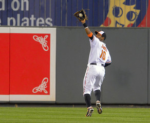 Baltimore Orioles Jones reaches up to make the catch as he races back on a fly ball off the bat of Toronto Blue Jays Lawrie during their MLB American League baseball game in Baltimore