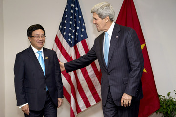 U.S. Secretary of State John Kerry meets with Vietnam's Foreign Minister Pham Binh Minh during an ASEAN meeting in Bandar Seri Begawan