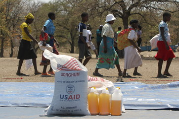 Women arrive to collect their monthly food rations sourced by World Food Programme (WFP), in the rural areas of Mupinga, Chiredzi, Zimbabwe
