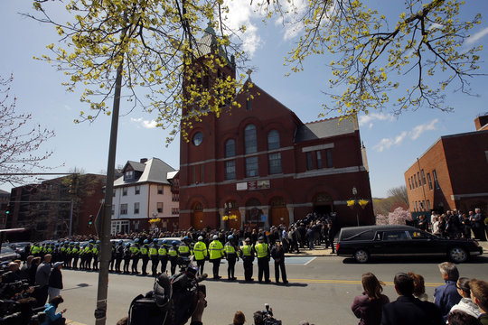 Friends and family of Krystle Campbell file into St. Joseph Church for her funeral in Medford