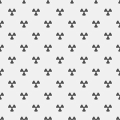 Abstract pattern. Black radiation signs on a white background. Irradiation. Dangerous area. Vector illustration in a flat style
