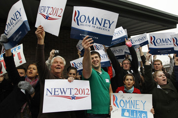 Supporters of U.S. Republican presidential candidates Mitt Romney and Newt Gingrich cheer outside a campaign stop in Greenville