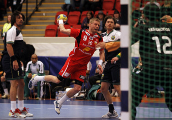 Iceland's Sigurosson scores against Brazil's goalkeeper Vasconcelos during their group B match at the Men's Handball World Championship in Norrkoping
