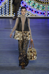 A model presents a creation by Italian designer Antonio Marras for Japanese fashion house Kenzo as part of his Fall-Winter 2011/2012 women's ready-to-wear fashion collection during Paris Fashion Week