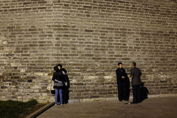 People rest at a section of the Ming Dynasty City Wall in Beijing