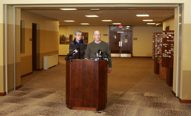 Paula and Ed Kassig, parents of U.S. aid worker Peter Kassig who was beheaded by Islamic State militants, read a statement to the press in Indianapolis