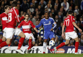 Chelsea's Drogba challenges Spartak Moscow's Pareja during their Champions League soccer match in London
