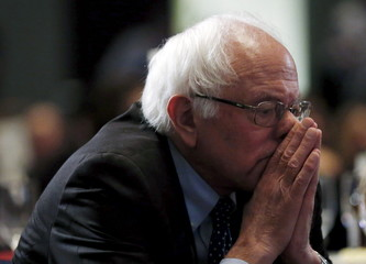 U.S. Democratic presidential candidate Bernie Sanders listens to remarks at the Iowa Democratic Party's Hall of Fame dinner in Cedar Rapids