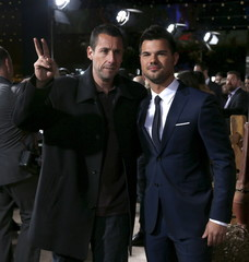 "Cast members Sandler and Lautner pose at the premiere of ""The Ridiculous 6"" in Universal City"