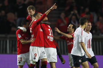 Paris Saint Germain's soccer players celebrate after scoring during their French Ligue 1 soccer match against Lille at the Parc des Princes stadium in Paris