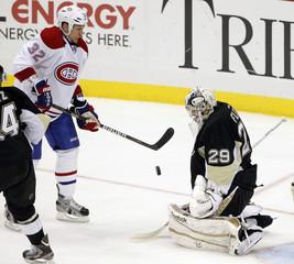 Pittsburgh Penguins goalie Marc-Andre Fleury blocks a shot by Montreal Canadiens Travis Moen in Pittsburgh