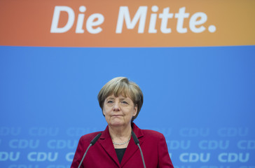 German Chancellor and head of CDU Merkel reacts during a news conference with her party's top candidate Dietrich Wersich at CDU headquarters in Berlin