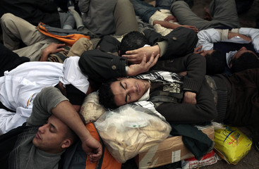 Protestors sleep during a mass demonstration at Tahrir Square in Cairo
