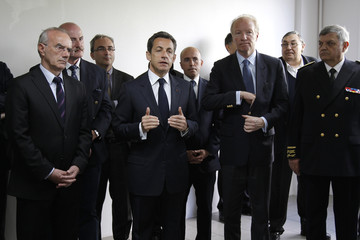 France's President Sarkozy delivers a speech as he visits the CIF bus depot in Tremblay-en-France