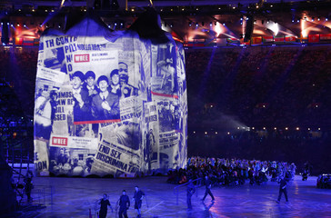 Images of newspapers are projected onto a structure during opening ceremony of London 2012 Olympic Games at Olympic Stadium